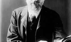 455px-George_Bernard_Shaw_at_desk_with_book
